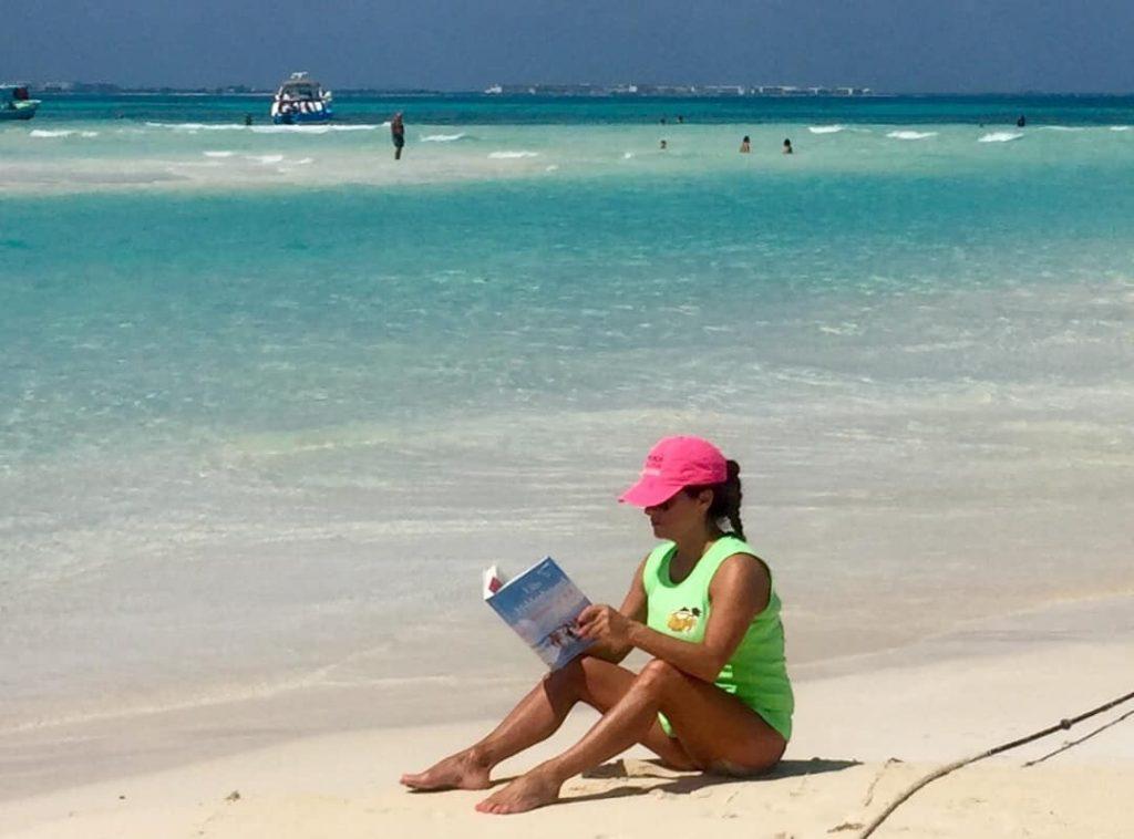 girl-beach-reading-vacation-golden-tan